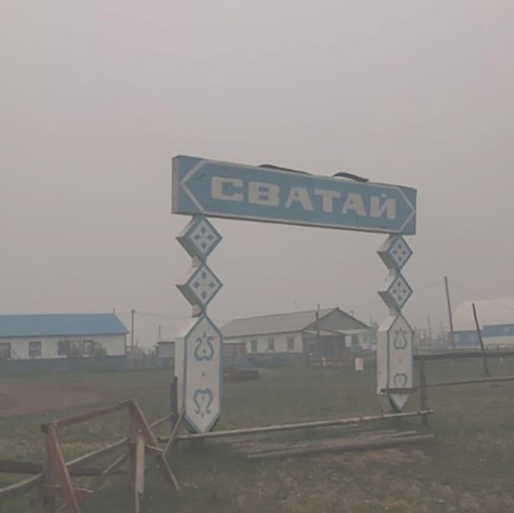 Desperate calls for help from Arctic village of Svatay caged by wildfires
