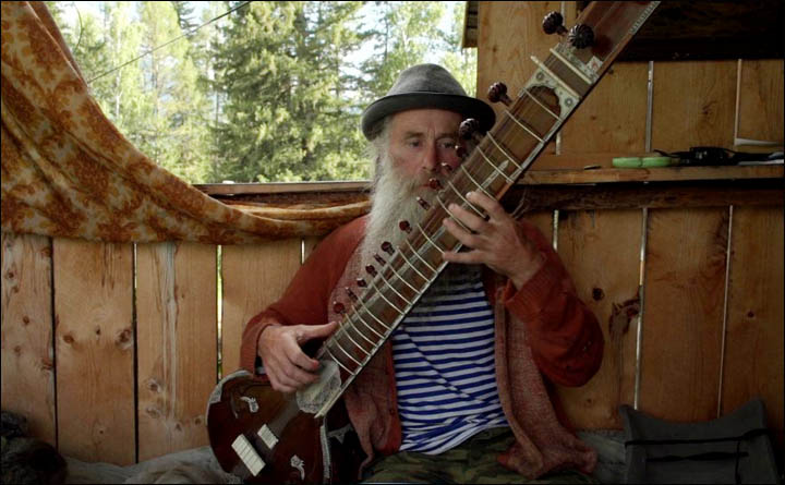 Old musician with sitar